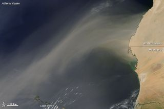 NASA's Aqua satellite captured a massive dust storm blowing westward over the Cape Verde islands from Africa in this image captured on Oct. 8, 2012.