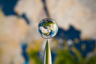 Earth in a water droplet