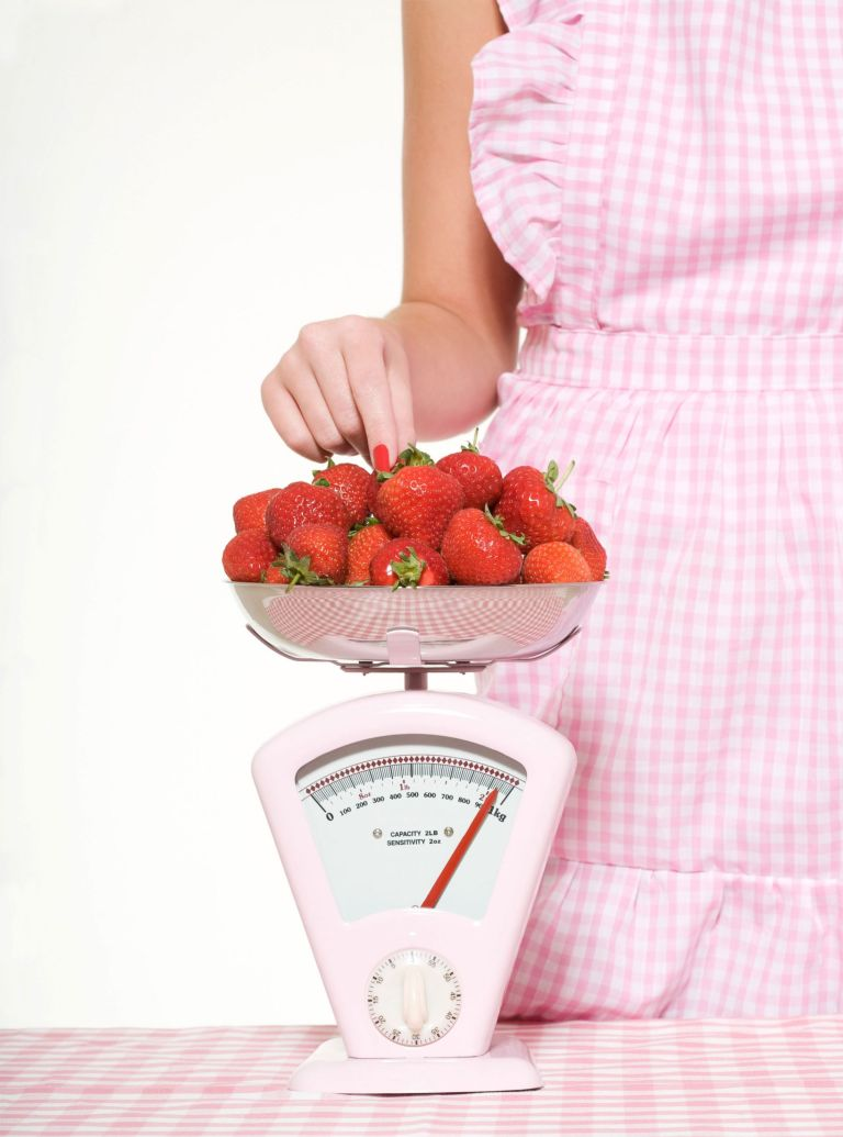 Woman-weighing-strawberries photo