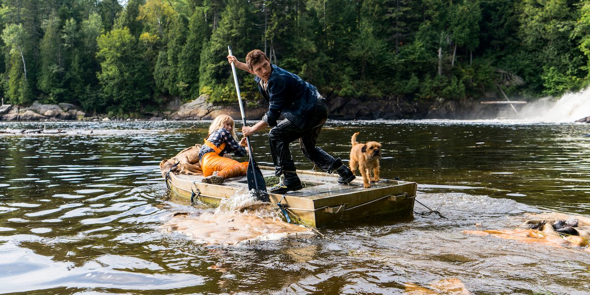 Daisy Ridley and Tom Holland on a river raft as Viola and Todd in Chaos Walking