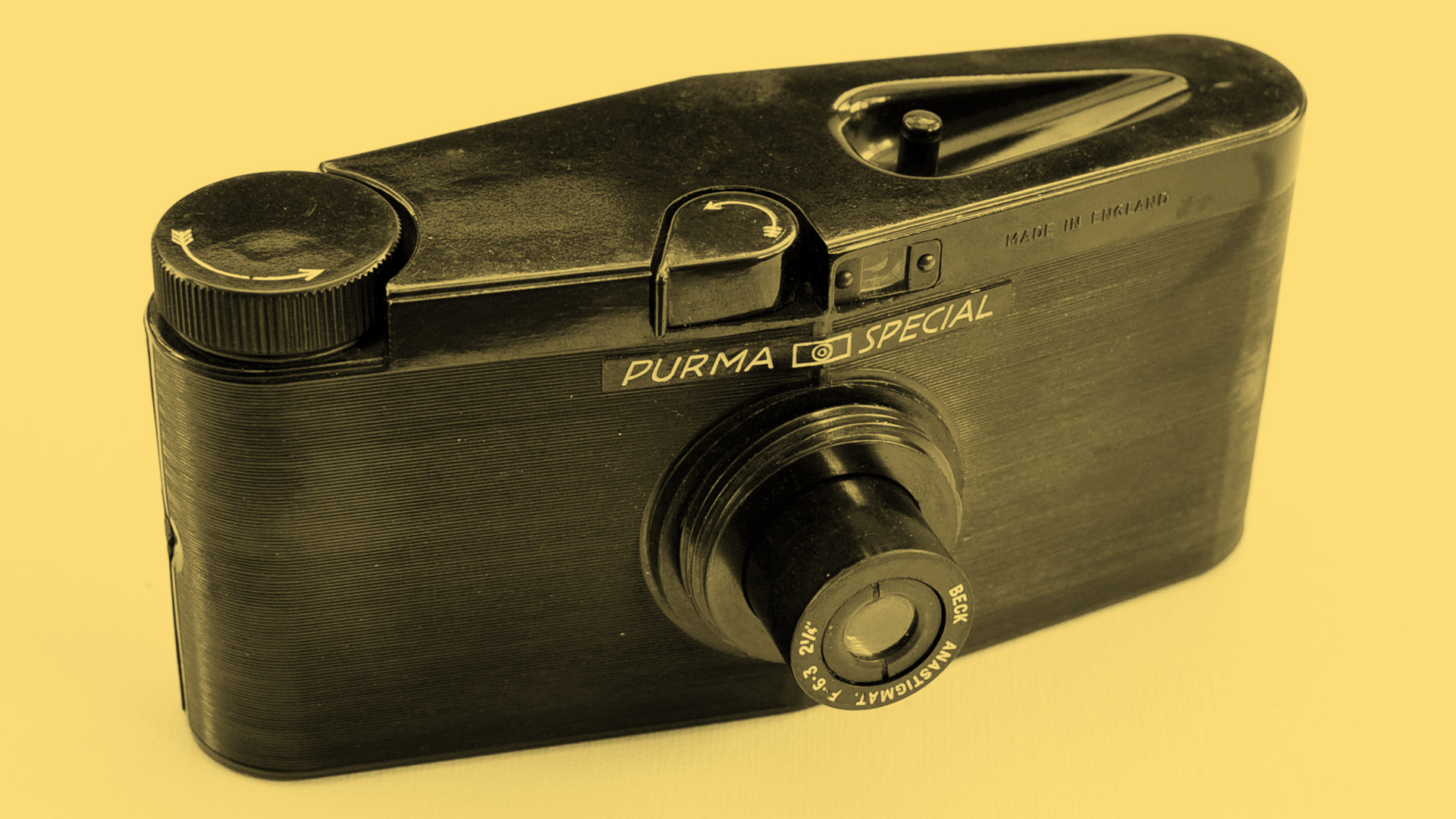 The front of the Purma Special camera on a yellow background