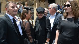Phil Rudd and Brian Johnson attend the service in Sydney