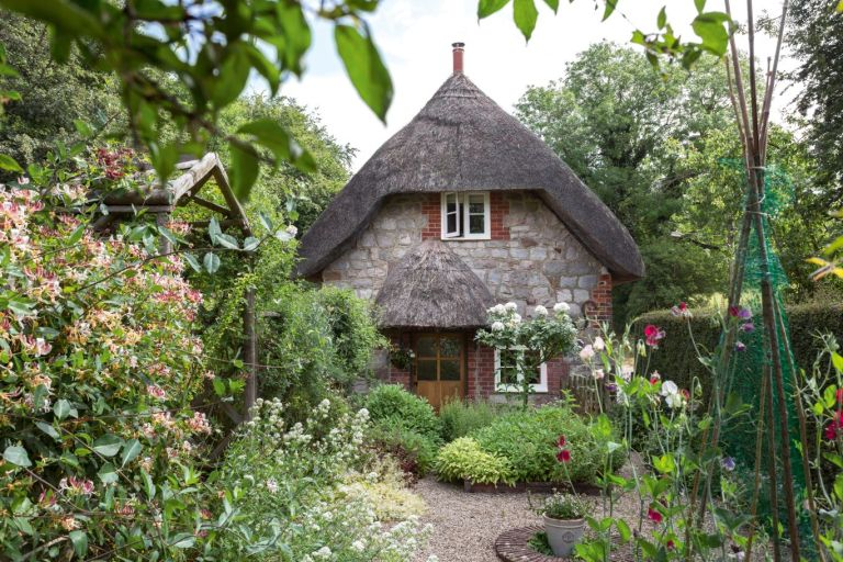 cottage garden ideas with a thatched cottage front garden