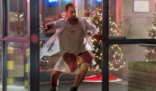 chris meloni in bloody hospital gown on happy