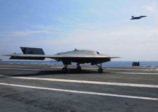 U.S. Navy drone aboard aircraft carrier.
