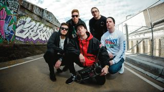 A press shot of Void Of Vision posing outside next to a graffiti wall