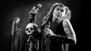 Ministry's Al Jourgensen with a mic stand made of a human skeleton