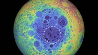 The South Pole-Aitken basin (represented by the shades of blue at the center) stretches 1,550 miles (2,500 kilometers) across and is one of the solar system's largest craters. The dashed circle indicates the spot where researchers found a weird material beneath the basin that contains metal.