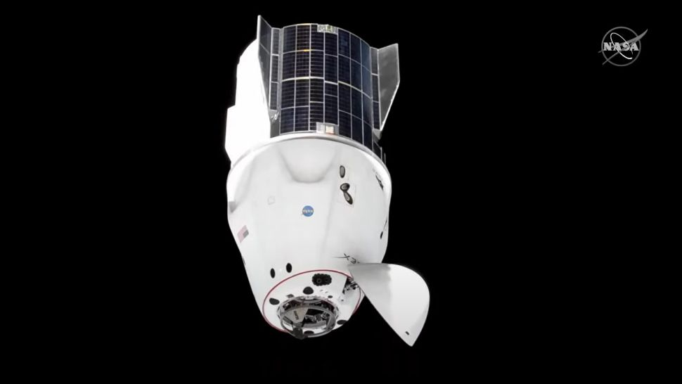 Astronauts move their SpaceX Dragon spaceship in orbit ahead of Boeing's Starliner launch
