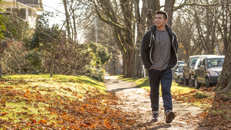 Man walking outdoors in autumn