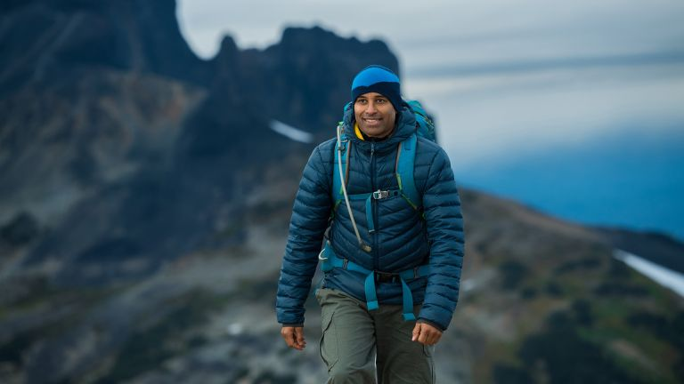 best walking trousers: man out hiking