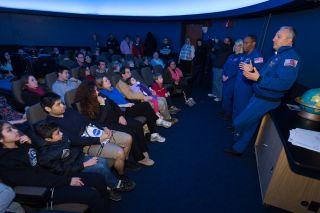 "NASA astronauts Kate Rubins, Alvin Drew and Mike Massimino give a star talk at a NASA ""Star Party,"" in the David M. Brown Planetarium at the Washington-Lee High School in Arlington, Virginia, on Jan. 19, 2013."