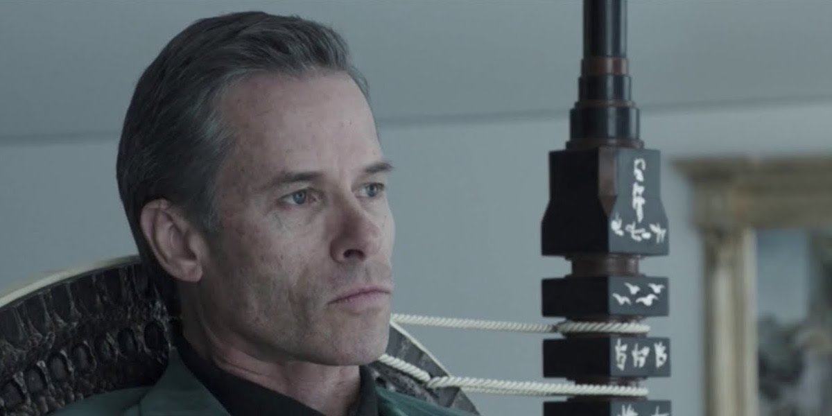 An aging Peter Weyland (Guy Pearce) sits in a chair in 'Prometheus'