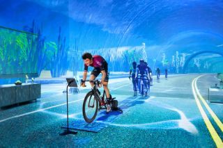 A cyclist competes in a virtual Zwift race online