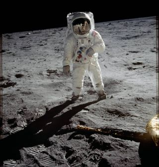 Astronaut Buzz Aldrin walks on the surface of the moon near the leg of the lunar module Eagle during the Apollo 11 mission in July 1969. Mission commander Neil Armstrong took this photograph with a 70-millimeter lunar surface camera.