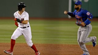 Red Sox Andrew Benintendi is chased between bases by Mets Robinson Cano