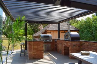 This outdoor kitchen idea has been made of brick in a garden