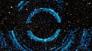 Concentric ripples in galactic dust clouds triggered by a black-hole burst.