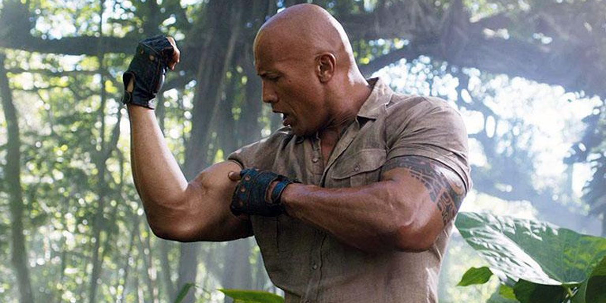 Dwayne Johnson flexing in Jumanji 2019