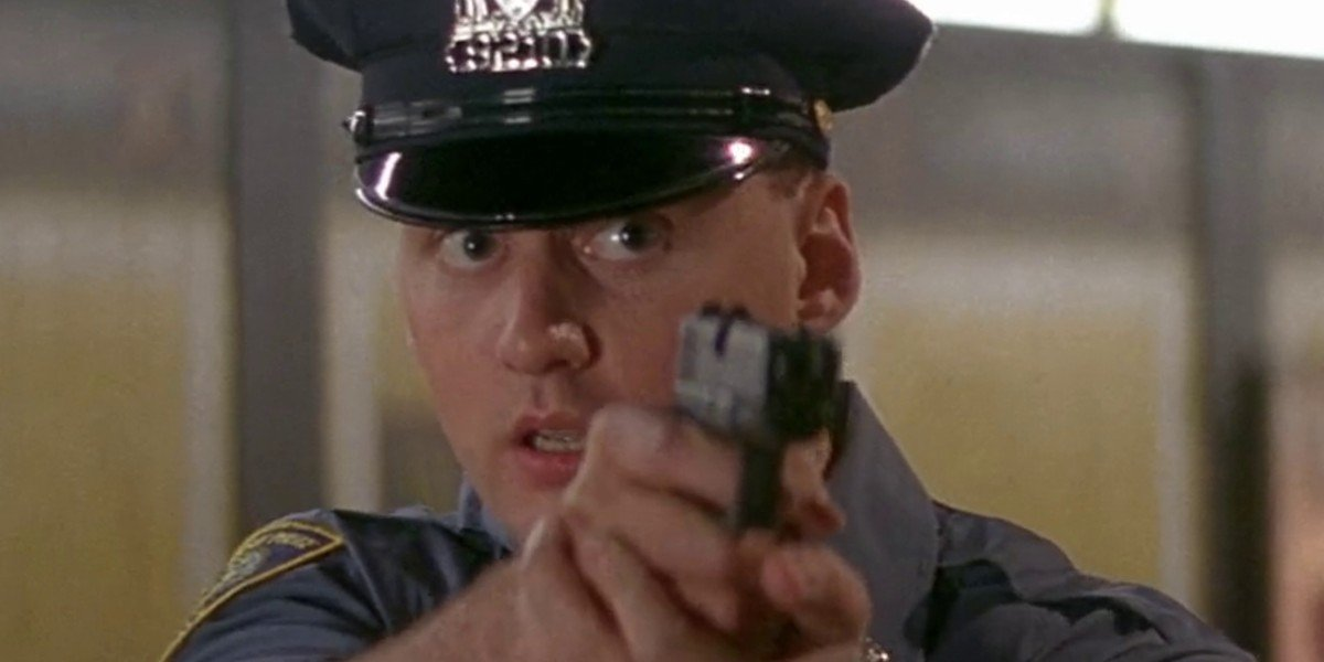 Police officer drawing his gun in Die Hard With A Vengeance