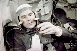 Cosmonaut Vladimir Shatalov aboard Soyuz 4 in January 1969, the first mission to dock two crewed spacecraft.