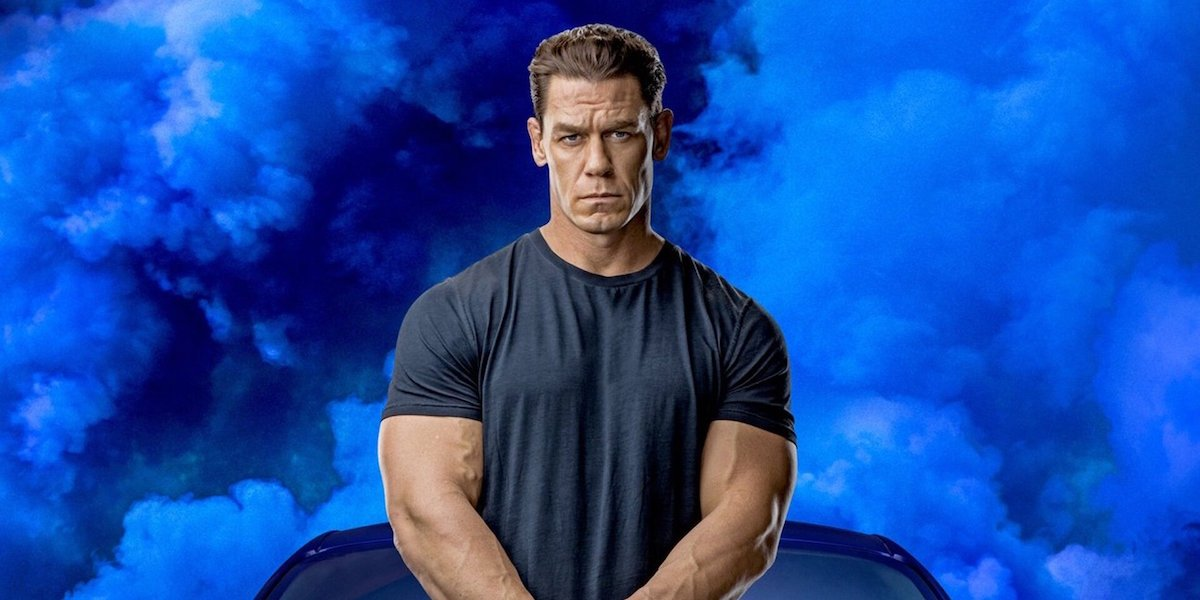 John Cena as Jakob Toretto, standing in front of a car and a blue background, in a promotional image