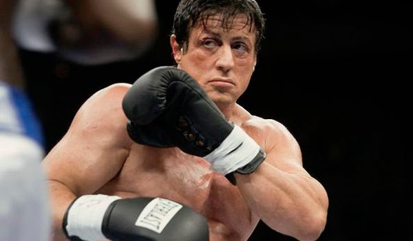 Rocky Balboa in the ring, guarding himself from an attack