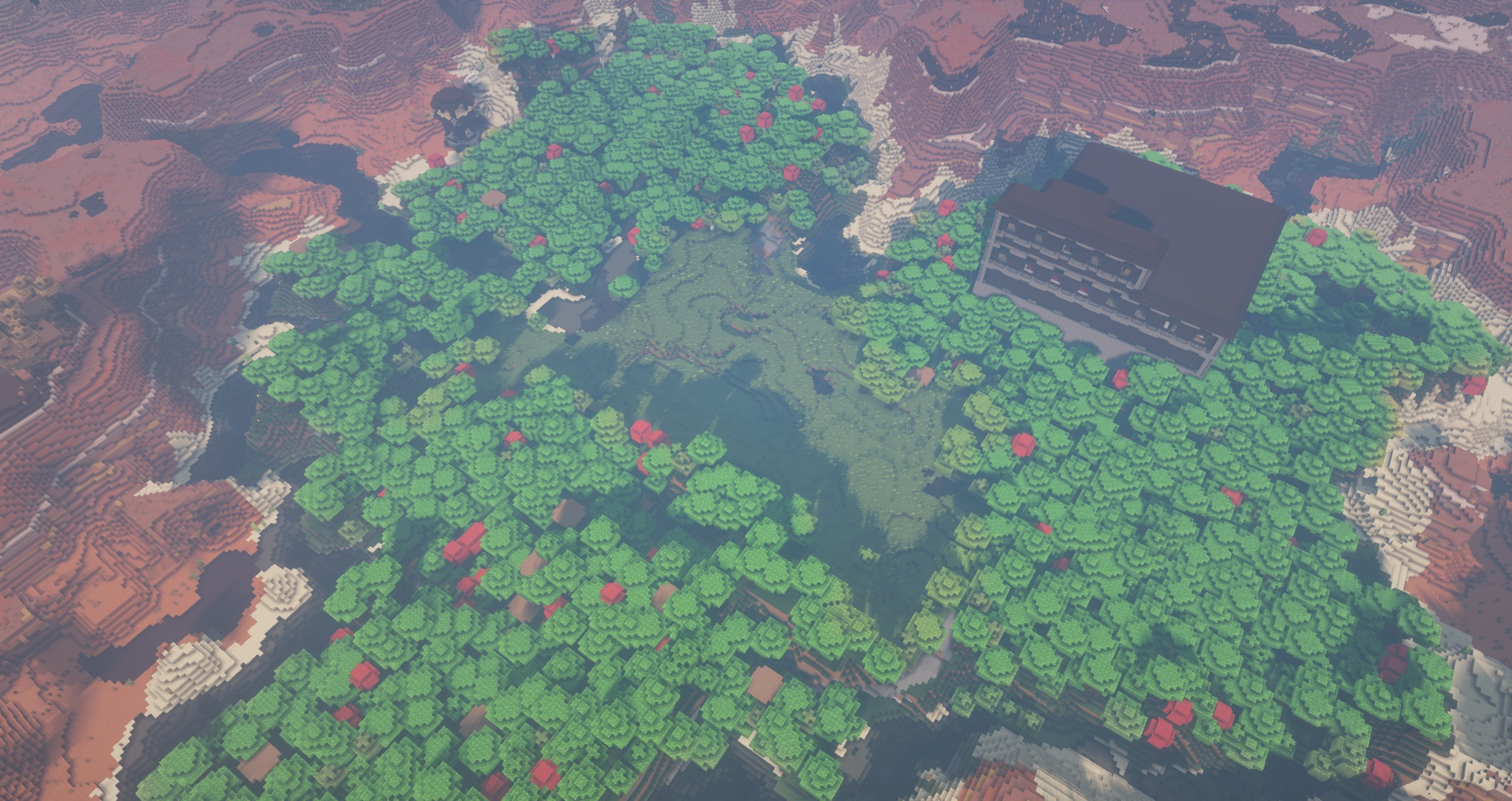 Minecraft seed - an aerial view of a forest shaped like a heart with a large mansion inside