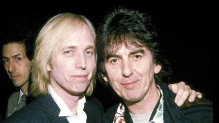 A photograph of George Harrison posing with Tom Petty