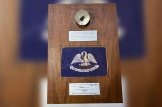 Louisiana's Apollo 17 goodwill moon rock display was returned to the state after being purchased by a gun collector at a Florida garage sale for its wooden plaque.