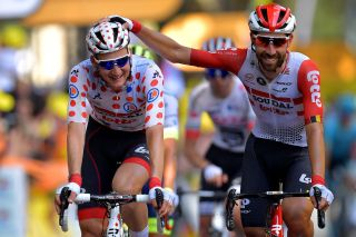 Tim Wellens – in the polka-dot jersey as the 'king of the mountains' leader – and Lotto Soudal teammate Thomas De Gendt share a joke on stage 11 of the 2019 Tour de France