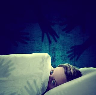 a man awake from a nightmare