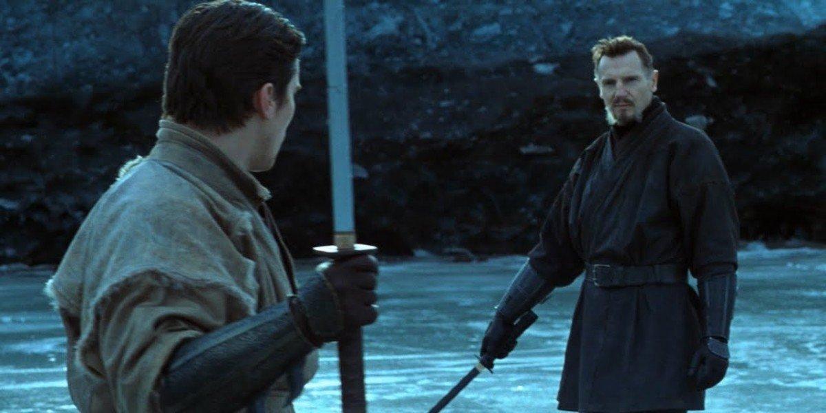 Bruce Wayne (Christian Bale) and Henri Ducard (Liam Neeson) face off in Batman Begins (2005)
