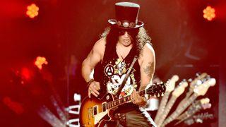 A photograph of Slash on stage at Coachella Festival