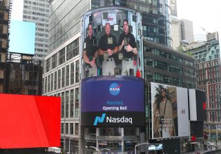 NASA astronauts (from left) Robert Behnken, Douglas Hurley and Chris Cassidy appear on Nasdaq's large television screen above Times Square in New York on June 2, 2020