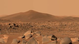 """NASA's Perseverance Mars rover used its dual-camera Mastcam-Z imager to capture this image of """"Santa Cruz,"""" a hill within Jezero Crater, on April 29, 2021."""