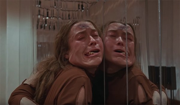 A dancer being thrown up against the mirrors in Suspiria