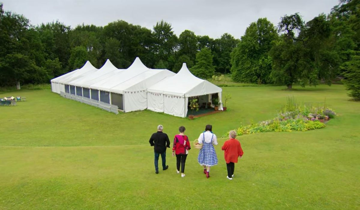 Great British Baking Show Paul, Prue, Noel, and Sandy walking to the tent