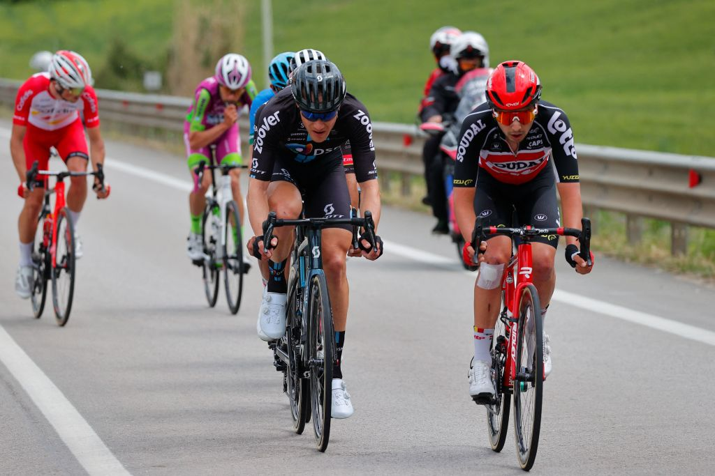 Team DSM rider Germanys Nikias Arndt L and Team LottoSoudal rider Belgiums Kobe Goossens compete during the eighth stage of the Giro dItalia 2021 cycling race 170 km between Foggia and Guardia Sanframondi on May 15 2021 Photo by Luca Bettini AFP Photo by LUCA BETTINIAFP via Getty Images