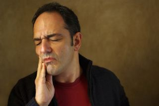man in pain with a toothache