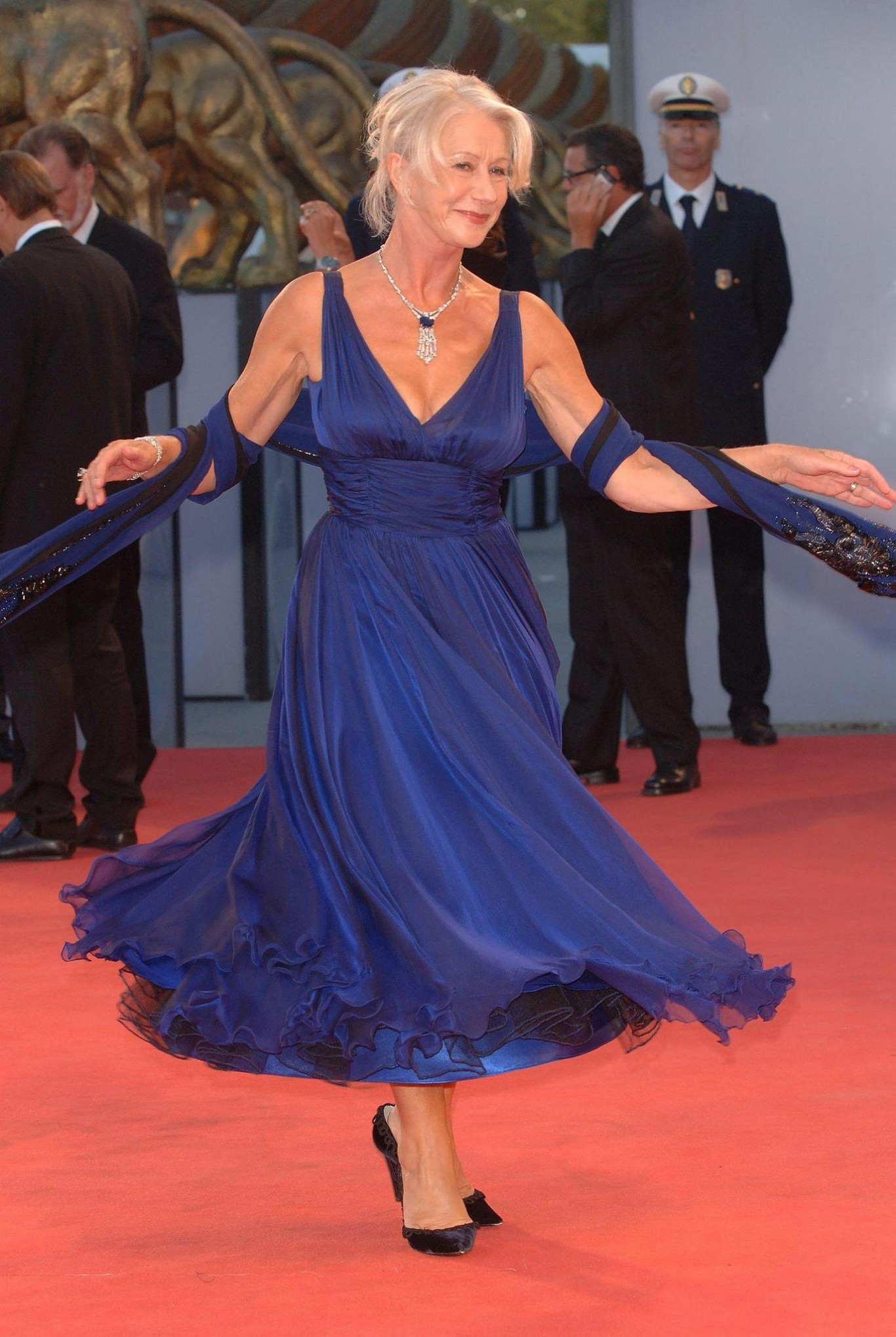 Helen Mirren swishes her skirt in a blue dress on the red carpet in Venice in 2006