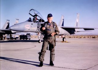 """Brigadier General Charles E. """"Chuck"""" Yeager standing in front of his F-15 Eagle on the 50th Anniversary of his becoming the first man to break the speed of sound in October 1997."""