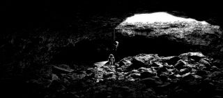 "What lurks within the moon's underground lava tubes? Entrances or ""skylights"" to lava tubes might allow future explorers access to subsurface ice."