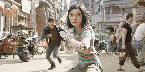 Alita: Battle Angel Alita takes a fighting stance on the streets of Iron City