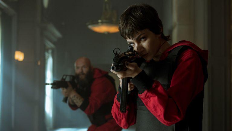 Netflix Money Heist guns red jump suits