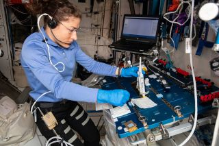 NASA astronaut Christina Koch working on the Genes In Space-6 experiment on the International Space Station.