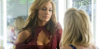 Hustlers Jennifer Lopez talks with another dancer in the dressing room