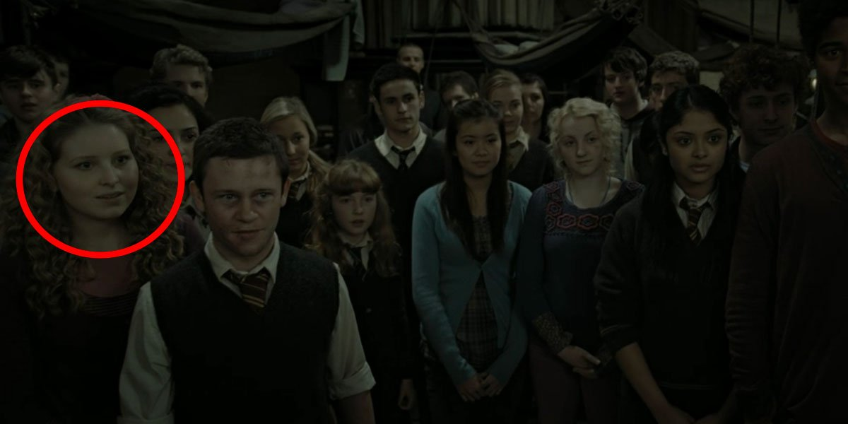Tons of Harry Potter characters inside the Room of Requirement including Lavender Brown who is circled.