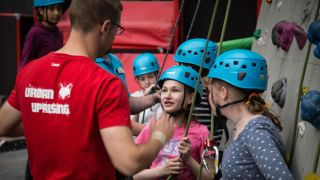 Young climbers learning the ropes at Urban Uprising