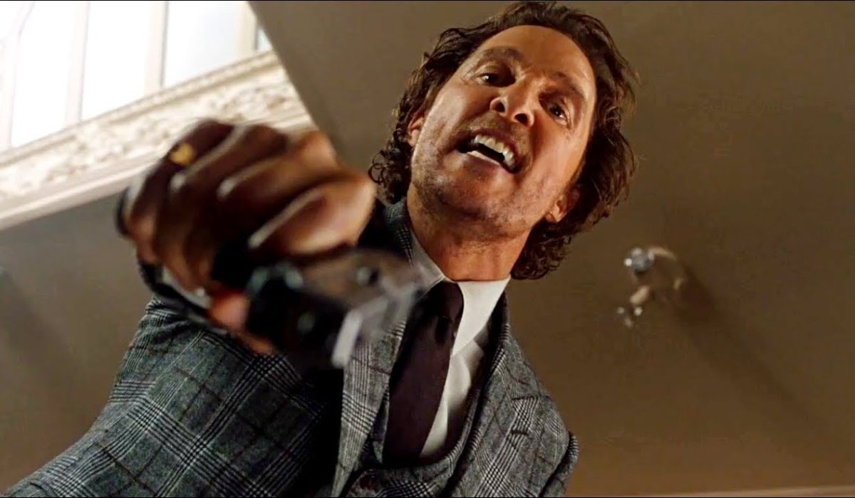 The Gentlemen Matthew McConaughey angrily aims his gun down at the camera